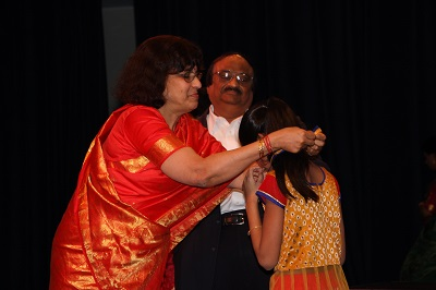 Mr. and Mrs. Lakshminarayan present the awards
