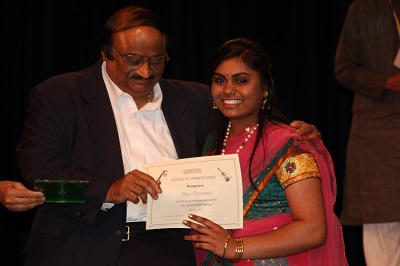 Mr. Lakshminarayan presents Divya, our emcee and graduating senior her certificate