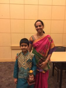 Avinesh with his first prize trophy along with one of the judges